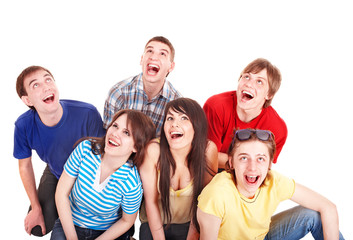 Group of happy young people looking up. Isolated.