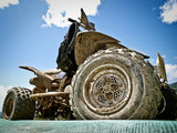 Fototapety Off-road dirt atv from low point against blue sky