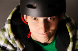 Young male bicyclist in helmet, studio shot. poster