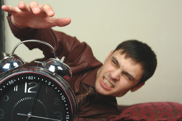 angry man hand and clock