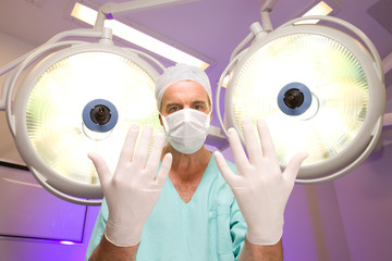 Surgeon with surgical gloves
