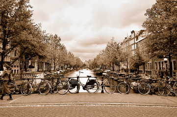 View of the Amsterdam center with bicycles on a bridge