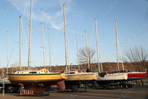 Row of Sail Boats stored on land