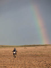 motorcycle player and rainbow