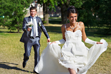 Groom catches bride at a wedding walk