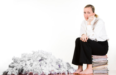 Woman with crumpled papers