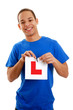 Teenage boy tearing L plate
