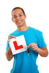 Boy holding car key and L plate