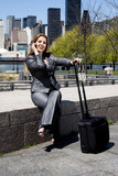 Traveling business woman on phone poster