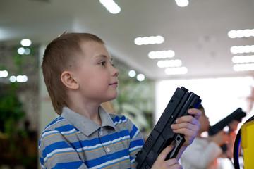 Boy in the children's amusement arcade. Video game.