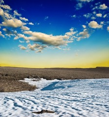 steppe in a snow at the evening