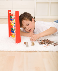 Little boy counting his savings