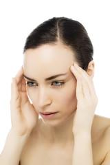 Gesicht einer Frau mit Kopfschmerzen