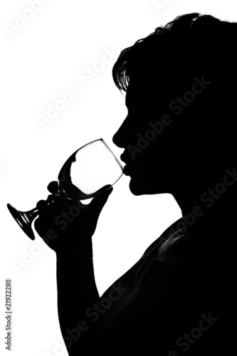 silhouette of a woman with glass