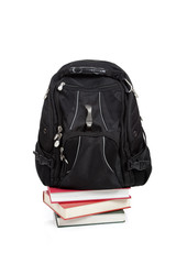 Black backpack with books on white