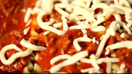 Making lasagna.