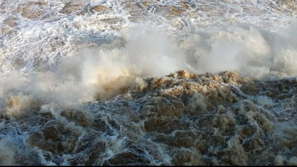Wild effervescent water after hydroelectric power station dam