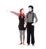 portrait of mimes. woman pointing at something