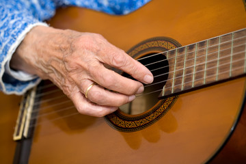 Old hands on guitar