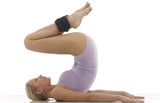 a young caucasian woman does gymnastics with ankle weights poster