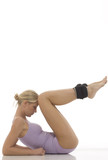 young caucasian woman does gymnastics with ankle weights poster