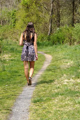 Teen girl walking on a path
