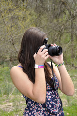 teen girl with a camera