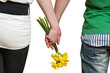 Couple holding flowers in hands isoalted on white