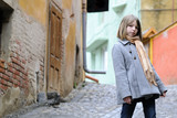 young tourist on medieval city streets