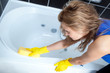 Young woman cleaning a bath