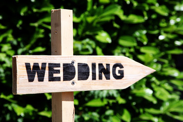 Signpost pointing to a wedding