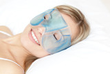Relaxed woman with an eye gel mask