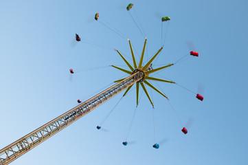 Flying swing carousel on fun fair
