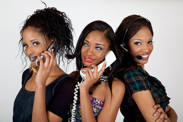 Three sisters on the phone