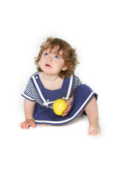 adorable toddler girl with green apple
