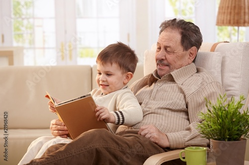 Grandfather reading tales to grandson