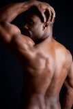 Strong African American man showing his muscular back