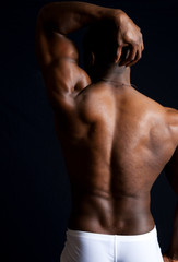 Strong man flexing his back muscles