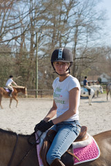 Young Woman Equestrian Training