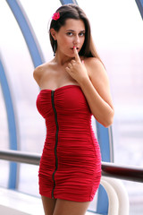 beautiful young woman in a red dress