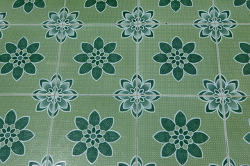 Carrelage vert à fleurs