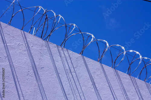 Wall with barbed wire.. Poster