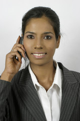 smiling indian girl on phone