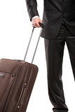 Business traveller with a suitcase (focus on the suitcase) poster