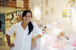 small business owner: proud woman opening her baby shop