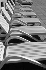 white resin solarium hammocks row