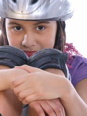 young girl wearing safety helmet & knee protection