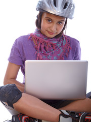 young girl relaxing with the laptop after rollerblading