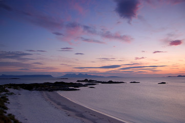 Sunset over Rum with new moon