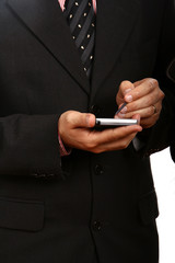 business man in blue suit working on pda or smartphone